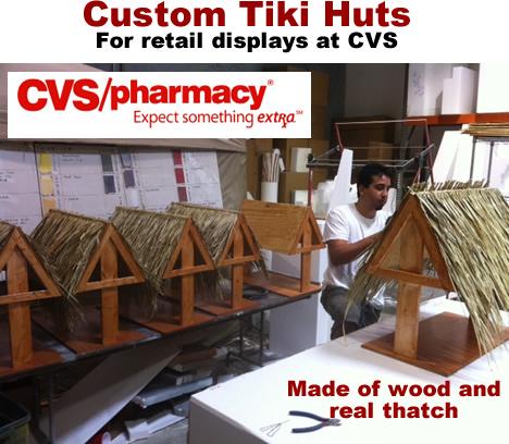 wood and thatch tiki hut retail displays
