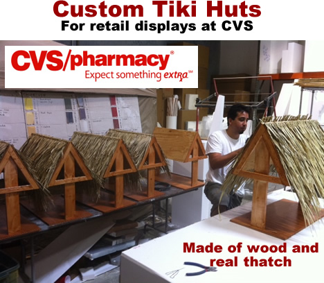 wood and thatch tiki hut retail displays